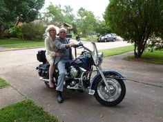 Here, the couple still rocks their wedding day wardrobe with an upgraded motorcycle. The location has also moved to their home where they've lived for the past 30 years. (Source: Reddit)
