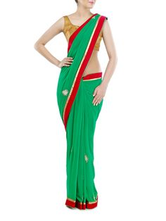 Svelte emerald green georgette saree with stones and crystals embellished motifs further enhanced with dark plum velvet panel on border comes with contrast dark plum beautiful intricate metallic embroidered unstitched blouse highlighted with crystals, also has matching blouse fabric.#sarees #sari #ethnic #Indiancollection #Indianweddingsaree #Indianweddingcollection #Lehenga #Suits #Indiansuits #Designercollection #designerwear