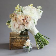 Clutch of chiffon tones with David Austin Garden Roses, roses, stock, peonies and lambs ear with a coordinating boutonniere (as seen in Charlotte Wedding Magazine) - Photographed by Logan Cyrus.