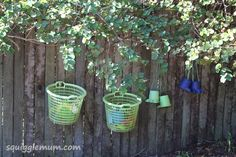 Baskets on the fence for easy kid-friendly outdoor storage.  (Important to make certain the baskets are mesh all around so rain doesn't accumulate, and spiders don't want to move in.)