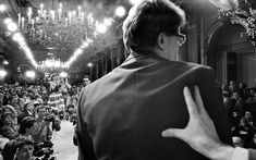 The crystalline wall -Shyness is a part of being human. The world would be a more insipid, less creative place without it .--- Photo :A shy Yves Saint Laurent is pushed onstage to be acclaimed for his Spring-Summer collection, Paris, January 1986 by Abbas/Magnum