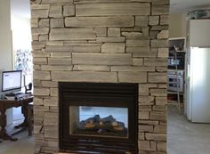 Black Saw Cut Natural Stone Fireplace by RR Masonry - Lethbridge AB