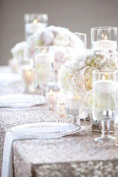 Simplistic Table Décor. Wedding on a budget? Why not add a sequin tablecloth for a more glamorous setting.