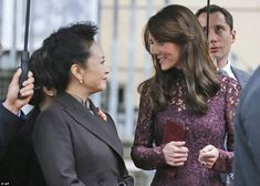 The Duchess of Cambridge looked relaxed as she spoke to Madame Peng outside the reception at Lancaster House
