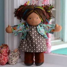 This is Joquil, a Classic Bamboletta from the January 20, 2012 upload. She has dark tan skin, long hair made with mohair and wool yarns in a brown color with brown and rainbow dreadlocks and blue eyes. She is wearing the pictured outfit, underpants and wool felt shoes.