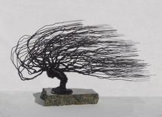 "The World of Real Bonsai by Oxemegifts.com-Please allow up to 14 days for delivery.Made of 22 gauge black steel wire. The sculpture is created using 22 gauge wire for a finer texture. The sculpture is mounted onto the base using a bonding agent. The base is a thick, mined, polished granite stone with small circular felt pads glued beneath.Wire sculpture - windswept styleMeasures 16""x6""x8"" tallBlack wire color, 5 lbs.Please allow up to 14 days for delivery."