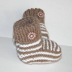 These tiny smart booties are very soft and knitted with love and care, to keep those little toes warm indoors and out.    Hand-knitted in quality