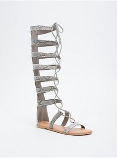 """These sandals were born to be wild. The knee-high gladiator style gets fierce AF with faux snake skin detailing the cutout straps. Lace up ties turn down the wild child antics (but like not really).<div><ul><li style=""""list-style-position: inside !important; list-style-type: disc !important"""">TRUE WIDE WIDTH: Designed so you never have to size up again. For the perfect fit, we recommend going down a whole size.</li><li style=""""list-style-position: inside !important; list-style-type: disc…"""
