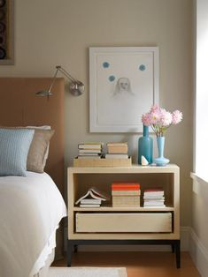 Master bedroom with nightstand by Holly Hunt and artwork by Kiki Smith from Pace Prints. The paint color is Tapestry Beige, OC-32, by Benjamin Moore.