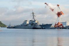 The destroyer USS Fitzgerald, damaged in a June 17 collision with a cargo ship, entered a dry dock in Yokosuka, Japan, for evaluation, the…