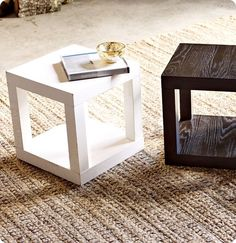2 cheap ikea tables, take the top off of one and make it into the base - now looks like an expensive West Elm cube table. Need a coffee table? Put two side by side.... You could get away with spending 30$ to get a side table in Canada - and not feel bad when your kids wreck it!