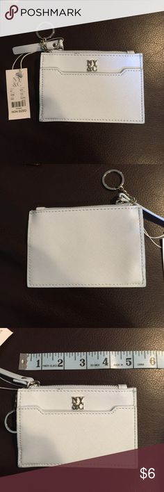 New York & Company Key Fob Coin Purse Light blue coin holder with key chain attached . Zipper opening at top and a front pouch. Brand new with tags attached. New York & Company Accessories Key & Card Holders