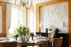 """""""Dining rooms need to work well in the evening, create a golden glow, and work well with a variety of tabletop settings. Orange lacquer with gold flecking is a color combination that doesn't prevent you from using a range of other palettes."""""""