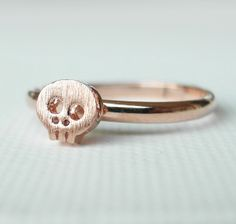 Skull ring, knuckle ring in pink gold, adjustable- If I saw a girl wearing this, I would actually find it quite adorable.