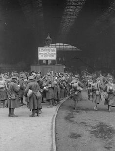 British troops queueing up to the money exchange office while arriving on leave at Victoria Station, London.