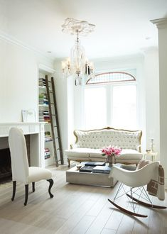 Fashionable #living room all in white...very chic! Love the #chandelier and the sofa! #interiors