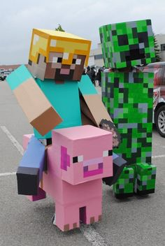 Minecraft Cosplayers....would be a good idea for my son! He wants to be a minecraft guy for halloween :-)