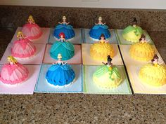 Mini princess doll cakes for my nieces birthday. Chocolate cake with vanilla buttercream. These were actually jumbo cupcakes turned upside down and carved. I inserted little Disney Princess figures in the middle. They loved them!