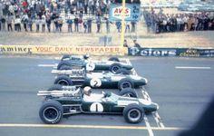 From the camera it is Jack Brabham, Brabham-Repco, Denny Hulme, Brabham-Repco) and Jim Clark, Lotus-Climax