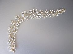 This stunning hair vine is made with beautiful Swarovski crystals that dazzle and sparkle with every move. This hair vine is super flexible and shapeable and can be worn as a headband or a hair vine. It comes with satin ribbons attached for tying it in the hair. It can also be