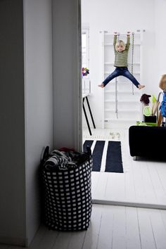 12 Great Kids Rooms: Ok, so who else out there had a trapeze in their room growing up? We thought so. This Scandinavian kids room with painted white floor and touches of black appeared in DEKO.