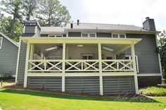 Horizontal boards instead of the commonly used lattice screening below the porch -- love the design of this covered porch addition