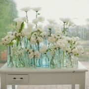 Great single table design for florals as a focal point for reception or ceremony.  Possibly a great backdrop for an outdoor ceremony.