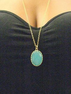 Long gold necklace - Vintage style with a turquoise stone. $35.00, via Etsy.