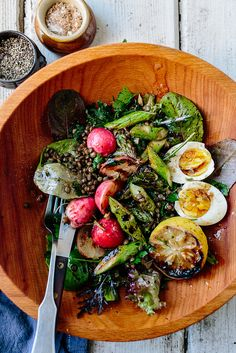 Lentil salad with spring greens, asparagus and a soft egg