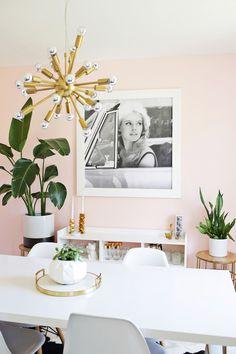 Gold Sputnik Chandelier via A Beautiful Mess | gold starburst chandeliers, pink walls