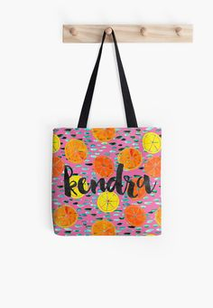 Personalized pink citrus tote bags with oranges and lemons, available in three sizes! Your choice of name or monogram, printed in a fun script. Made in the USA, ships worldwide. Orange and lemon print with turquoise dots on a bright pink background.