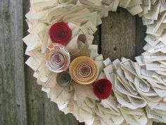Vintage Hymnal Wreath with Red Rosettes. $40.00, via Etsy.