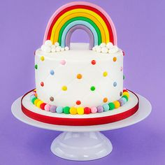 A rainbow cake is fun to look at and eat and a lot easier to make than you might think. Here's a step-by-step guide for how to make a rainbow birthday cake. 4th Birthday Cakes, Rainbow Birthday Party, Belle Birthday Cake, 1st Birthday Cake For Girls, Birthday Ideas, Salty Cake, Girl Cakes, Savoury Cake, Cookies Et Biscuits