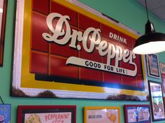 Dr Pepper sign on the wall in Kinkaid's burger joint.
