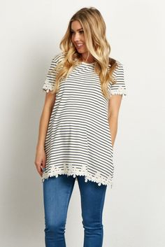 Stripes just got a little more pretty with this floral trim maternity top. Short sleeves will keep you cool while showing off your belly from week to week. Style this top with maternity jeans and flats for a chic look.