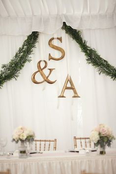 Cute head table backdrop. Photo by Brandon Scott.