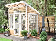 In between the raindrops my motivated hubby built this privacy wall to frame the greenhouse. This area of our yard has become a problem… Cottage Garden Design, Cottage Garden Plants, Cottage Gardens, Greenhouse Shed, Privacy Walls, Large Sheds, Roof Styles, Potting Sheds, She Sheds