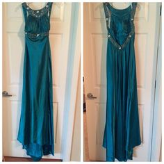 **TERANI TURQUOISE gown** Prom season is right around the corner! Only worn twice once for a prom and the second for a pageant! Small defect as in picture 3 but can be fixed easily by a seamstress! Other than that it is great condition!!!!  make sure you take a look at the size chart to make sure... I am a jean size 4 usually so they run a little bit small as many prom gowns.... Price cut just made Terani Couture Dresses