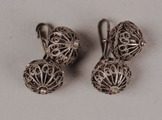 Pair of buttons made of silver filigree wire. Probably for a woman's jacket or bodice. Bosnia. 20th century