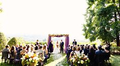 large urns of flowers for the ceremony