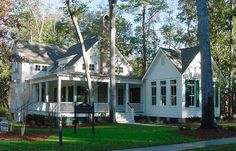 love the mature trees, the exterior design and the lush green grass - so serene #homeexterior