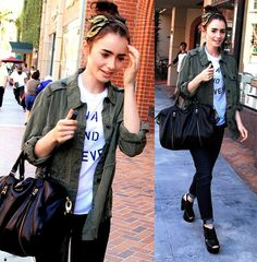 Lily Collins in casual outfit. Army jacket, graphic tee, skinny jeans, and heels.