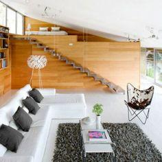 Una casa decorada al estilo y zen y con la madera por material decorativo.