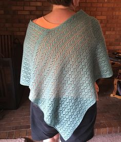 Mint green lace poncho.