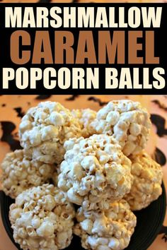 These Marshmallow Caramel Popcorn Balls are a delicious chewy, gooey treat!  They're a perfect treat for little ones, school parties or a Harvest Party!  A simple caramel syrup is combined with mini-marshmallows to create a batch of chewy, gooey popcorn balls. #popcornballs
