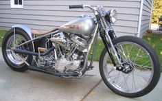 This Harley Bobber has a highly modified wishbone frame with hidden wiring, and an in-line springer front end. Description from panhead-bobbers.com. I searched for this on bing.com/images