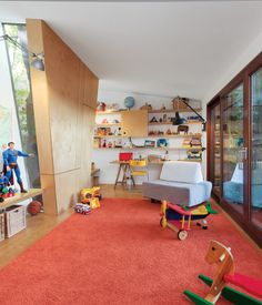 """""""When our older son Edouard was two and Victor was on the way, we decided to expand. We were tripping over the kids' toys. So we designed two additions: a playroom and an office,"""" says Paul Bernier of his Montreal renovation. One wall section in the playroom juts in to sidestep a mature tree outside, while slender windows allow the kids to monitor its progress through the seasons."""
