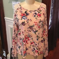 SPRING! Pink Floral Open Shoulder Top L PERFECT FOR SPRING! Pink Floral Open Shoulder Top size large. Open shoulder part has lace trim. So pretty!! No tags, but never worn. Deb Tops Tunics