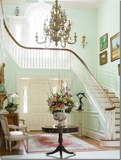 Architectural Styles: Georgian home with a curved staircase and mint green walls, along with the foyer and the chandelier. Georgian Interiors, Georgian Homes, Beautiful Interiors, Beautiful Homes, Curved Staircase, Staircase Design, Grand Staircase, Entry Foyer, Rustic Entry