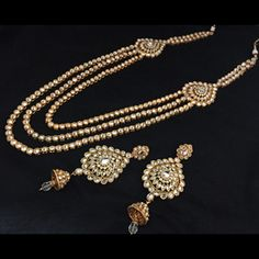 The set is designed with 4 chains layered with hanging gold balls teemed together to form an exclusive #Rani_haar in shine finish.